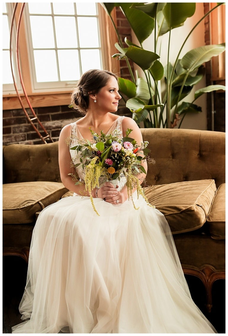 portrait of bride looking over shoulder and bouquet