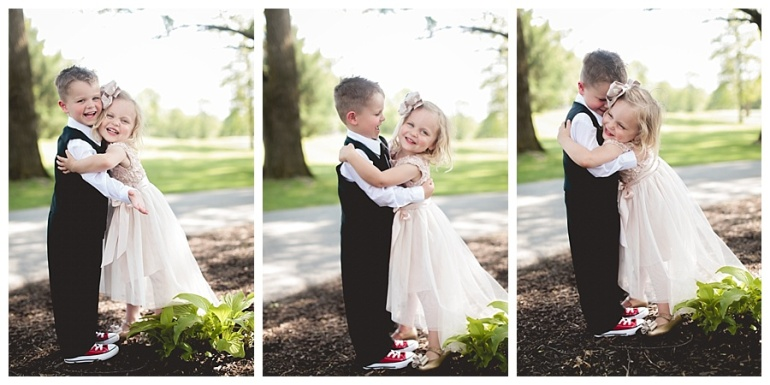 flower girl and ring bearer hugging laughing smiling